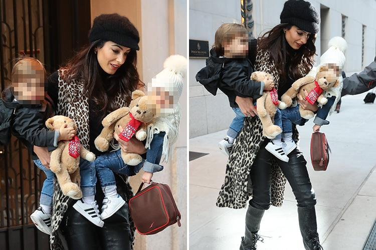 Amal Clooney looks seriously glam in leather trousers and boots as she cradles twins Alexander and Ella in New York