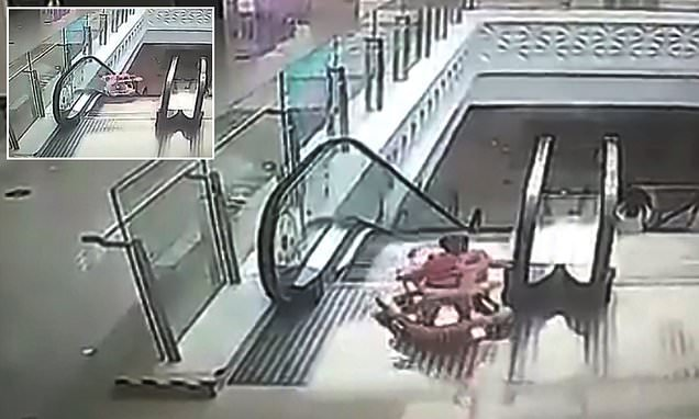 Baby toddling around a mall unattended tumbles down an escalator