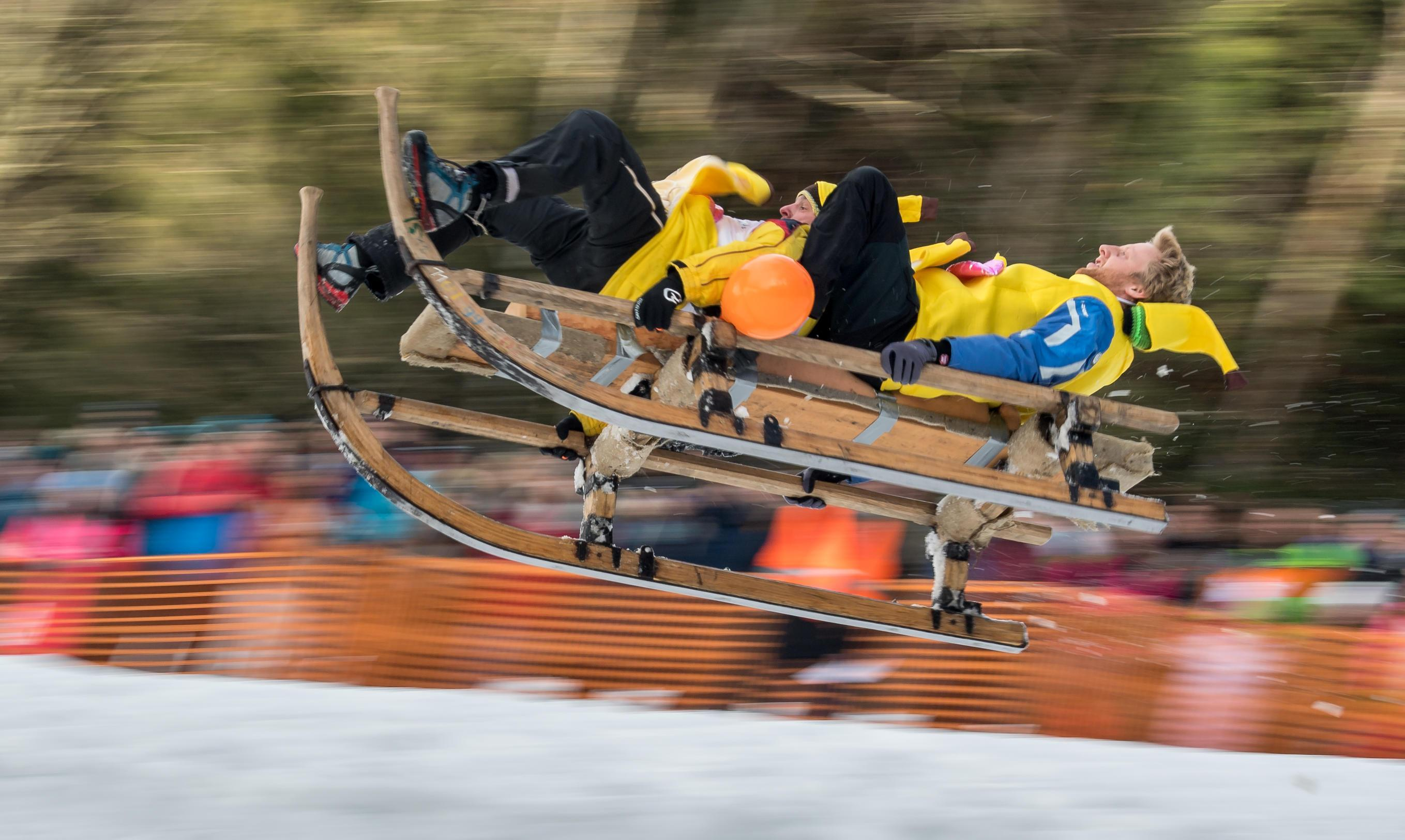 German sledge race with NO BRAKES sees daredevils fly down one-mile track with a jump