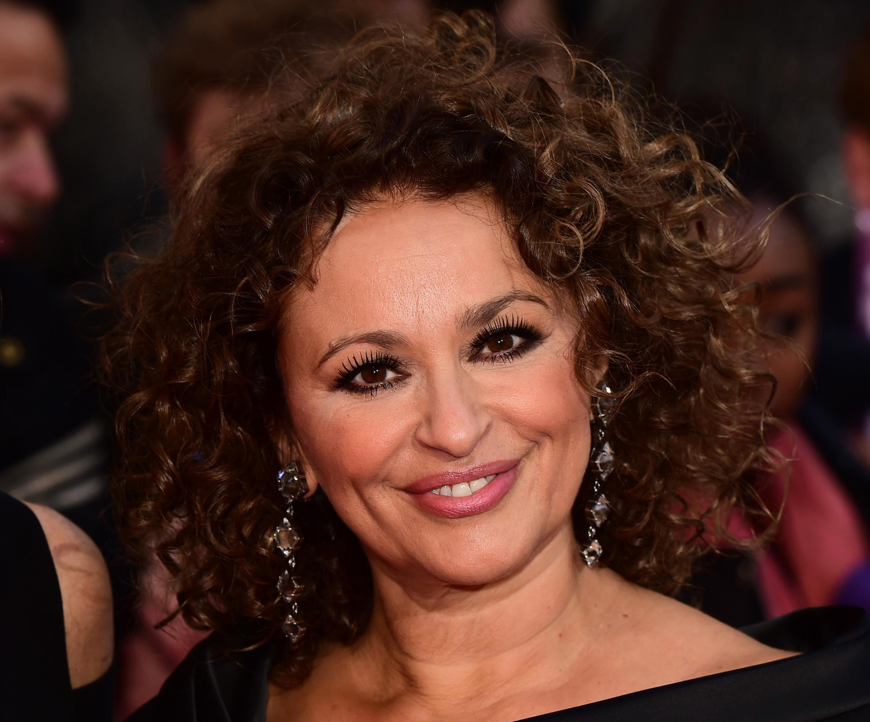 Who is Nadia Sawalha's husband, did she have a secret feud with Kaye Adams and when was she in EastEnders?