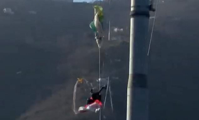 Horrific moment parachutist is killed after crashing into cable car