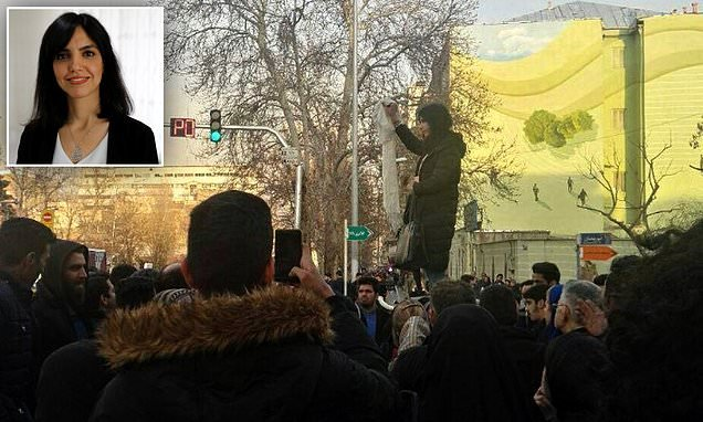 Iranian mother who carried out headscarf protest did it for daughter