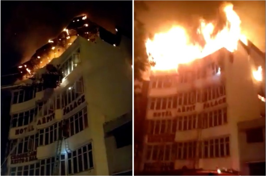 Dehli hotel blaze leaves at least 17 dead including woman and child as huge fire engulfs entire top floor as 'wedding party' slept