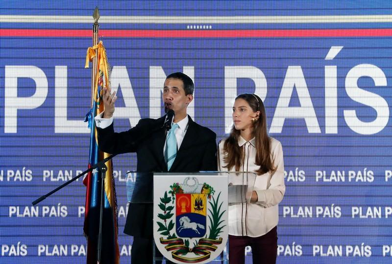 Venezuela's Guaido says police agents visited his home