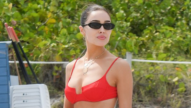 Olivia Culpo Gives Major Summer Vibes By Lounging On The Beach In Tiny String Bikini
