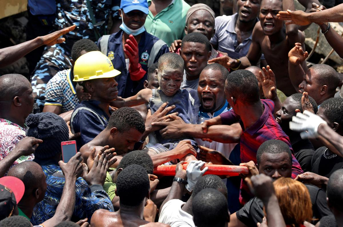 Nigerian boy pulled from rubble remains calm amid chaos