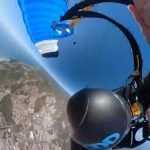 Heart-stopping moment a wingsuit pilot's parachute tangles in mid-air