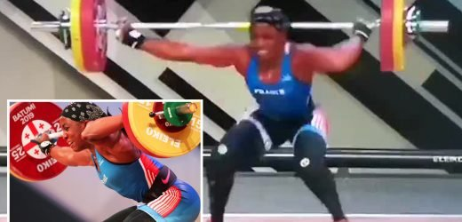 Female weightlifter's arm SNAPS in two places during attempted lift then writhes on floor in agony