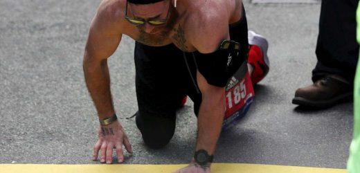 Runner Heroically Crawls Across Boston Marathon Finish Line — But Why He Ran Is Even More Inspiring