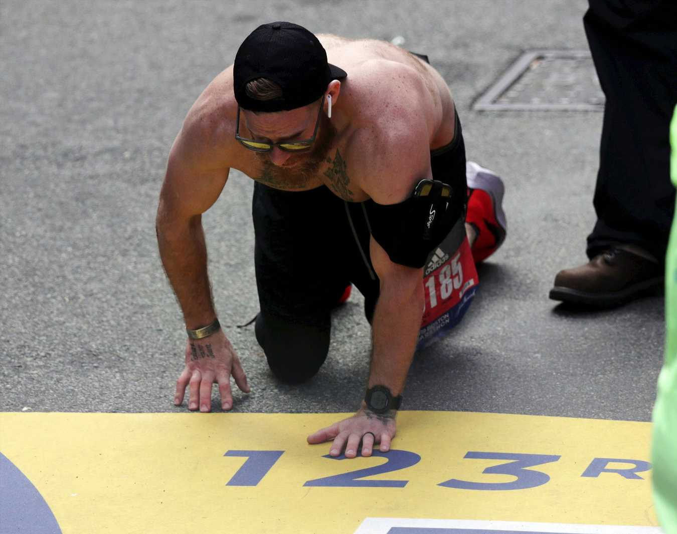 Runner Heroically Crawls Across Boston Marathon Finish Line — But Why He Ran Is Even More Inspiring