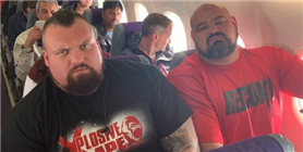 Strongmen Eddie Hall and Brian Shaw Had the Most Uncomfortable Flight Ever