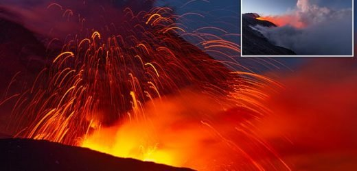 Mount Etna erupts and shoots jets of lava and volcanic ash into air