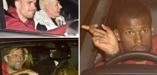 Liverpool heroes leave Anfield late at night still beaming… with Henderson even giving his mum a lift