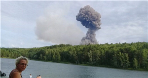 Dramatic moment Russian military warehouse explodes into fireball after blast