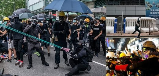 Protesters use slingshots to hurl rocks at police station in Hong Kong