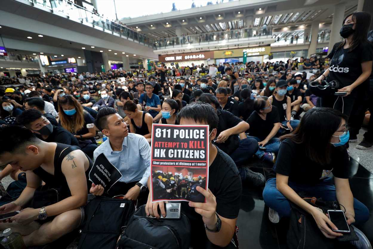 Hong Kong airport chaos as hundreds of protesters storm departure lounge after leader Carrie Lam warns the city is plunging into the 'abyss' – The Sun