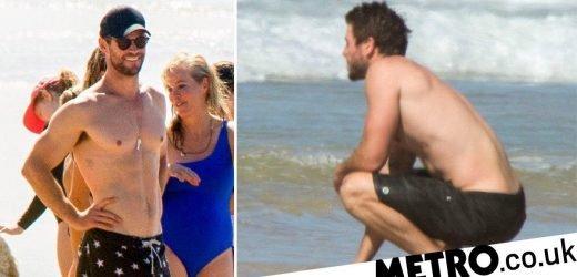 Chris Hemsworth has a blast as 'heartbroken' Liam looks glum during beach day