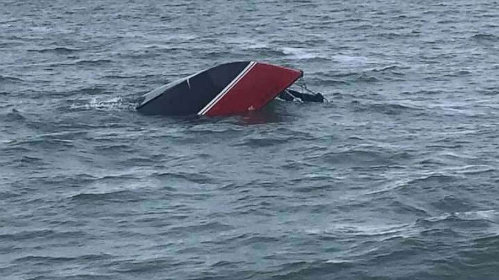 Man clinging to capsized sailboat for 12 hours rescued by boaters
