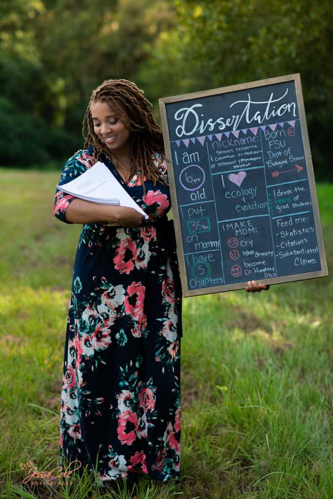 Florida Woman Poses with Dissertation in Hilarious 'Maternity' Photo Shoot: 'I Got My Baby!'